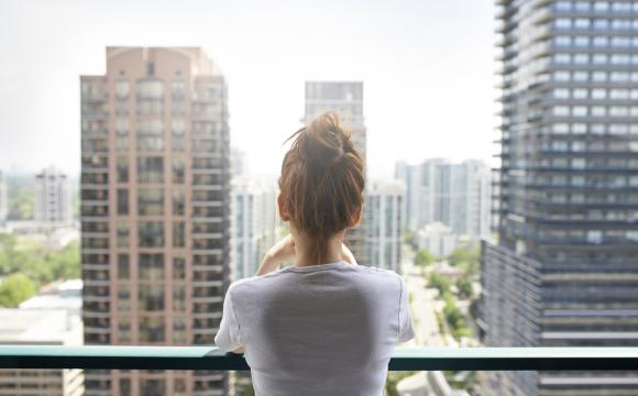 lady overlooking high rise building